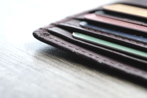 wallet with bank cards on wooden table