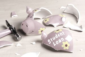 broken piggy bank and hammer