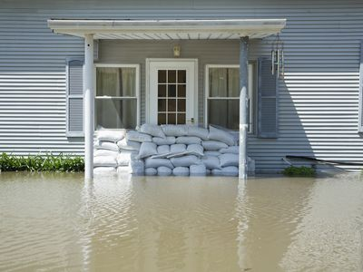 Flooded home with sandbags.