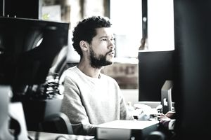 Young casual businessman portrait working on a computer