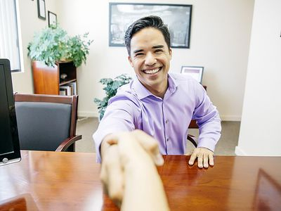 a young man shaking hands