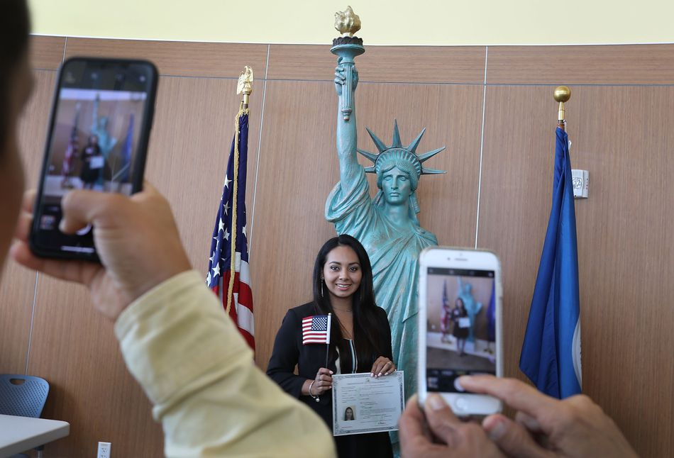 Naturalization ceremony for young immigrant