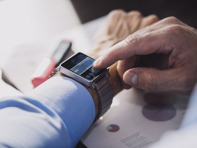 A man checking his index funds on his smart watch