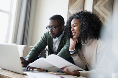 Couple with laptop reviewing investment portfolio online