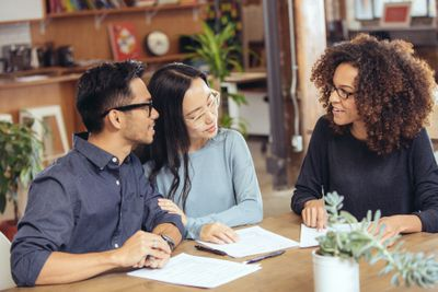 Couple working with their mortgage officer