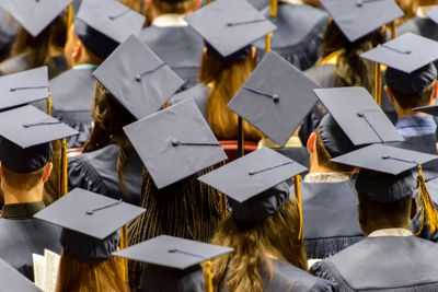 Group of college graduates in cap and gowns during Convocation Ceremony