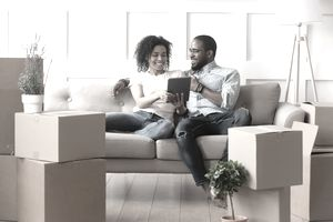 A couple looks over their closing documents on their new home.