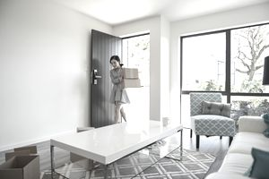 Young Asian Woman Moving In To New Home