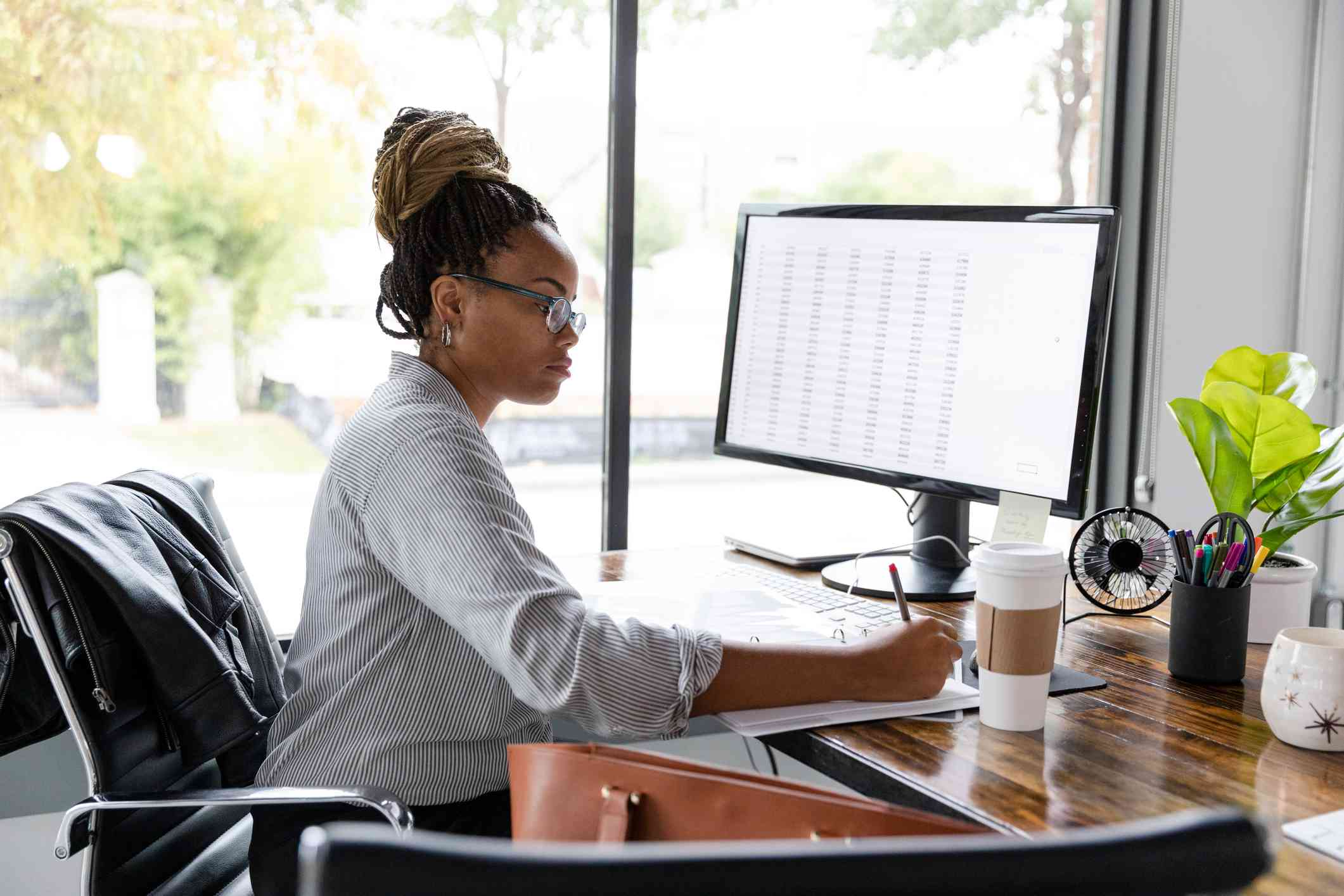 Busy businesswoman concentrates while working at her desk