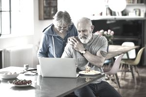 Mature couple reviewing finances at home