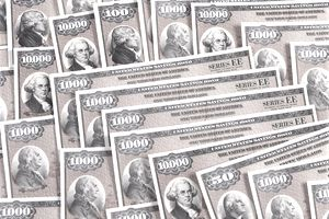 US Savings Bond certificates in various dollar values.