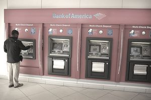 A man uses a Bank of America ATM.