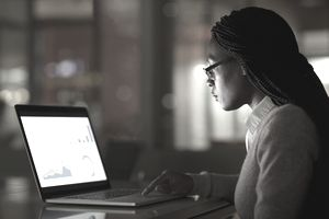 Young woman creating presentation on laptop.