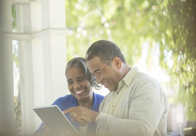 mature couple looking at tablet