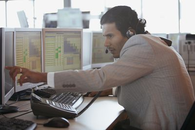 Financial trader making a call about a stock