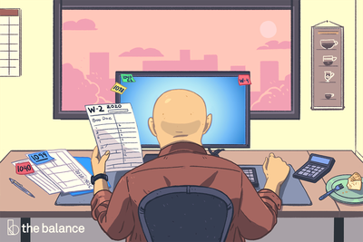 Image shows a man sitting at a desk going through a W-2, a 1099, and a 1040
