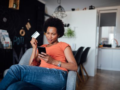 Attractive and happy African American woman shopping online