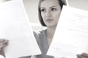 Woman reading through financial statements