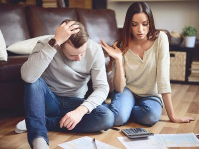 Couple in home interior fill out a tax return