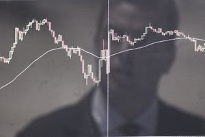 man looking at stock trend