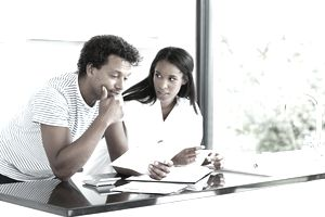 Couple reading financial documents