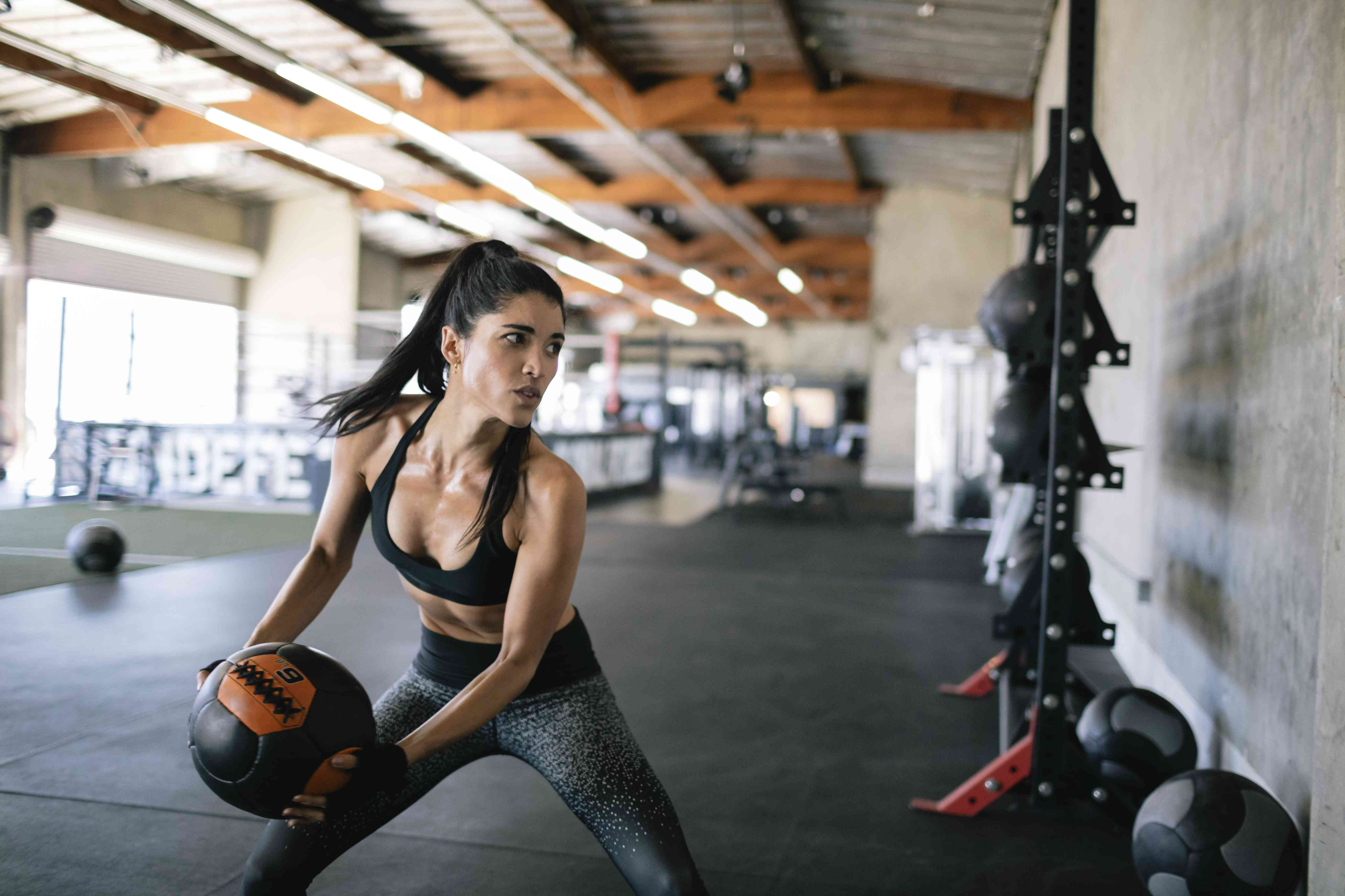 Woman exercising with medicine ball