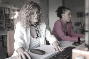 Two business women working at the office.
