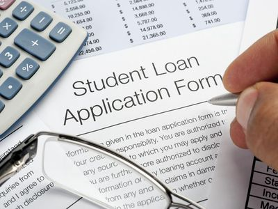 Student Loan application Form with pen, calculator, and glasses