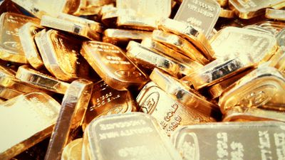 Gold bars loosely piled up
