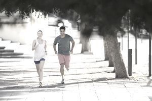 Couple running in the city, beating stress to get pregnant