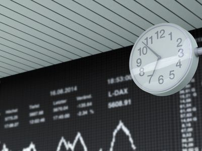 Germany, Stock exchange trading and clock in the foreground