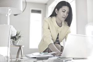 Female financial advisor working on laptop in home