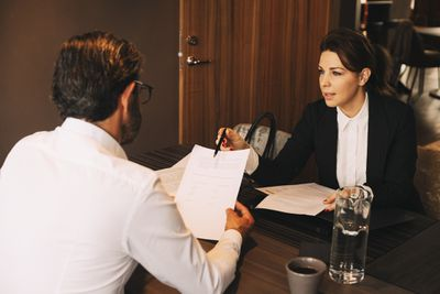Lawyer explaining paperwork to a client