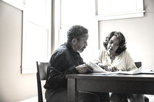 Senior couple paying bills at home - stock photo