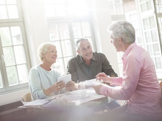 elderly people discussing finances
