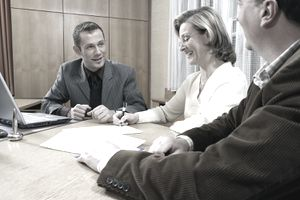 Three People in Business Meeting, Smiling