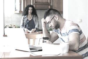 Worried man working at home