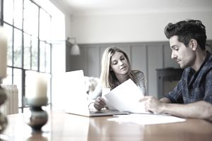 Couple reviewing investment paperwork
