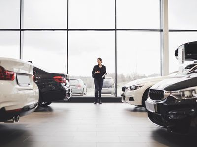A woman looks over potential new-car buys