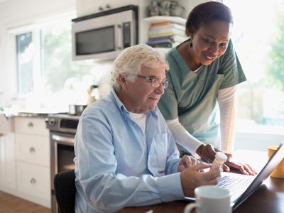 older man with nurse at home