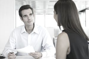 Woman meeting with a lander to review paperwork
