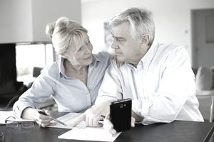 an older couple having a discussion at a table