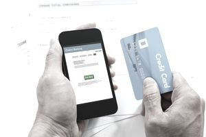 Man holding a smartphone and credit card