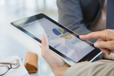 An investor is looking at stocks on a tablet