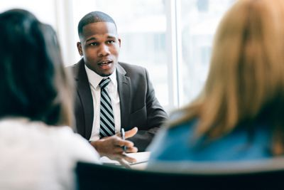 Investment advisor discussing Vanguard Funds with clients