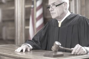 Judge banging gavel in court