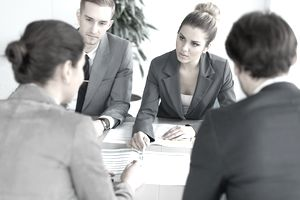 Four businesspeople in an office meeting