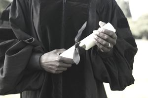 College graduate with diploma who now must pay student loans