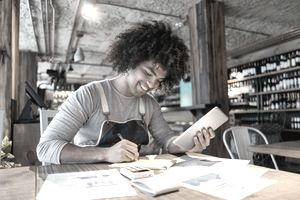 Smiling bookkeeper working at a restaurant