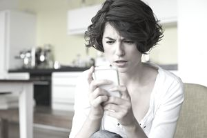 Woman receiving a text message